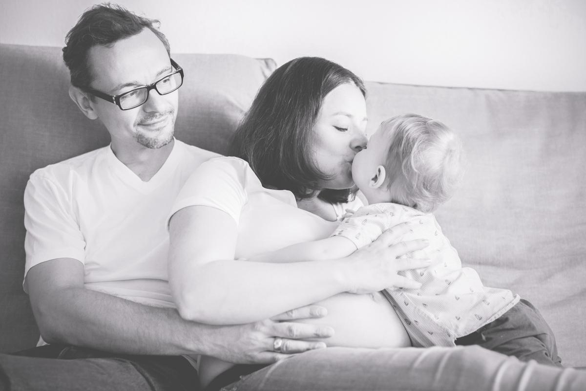 Familienfotos mit Babybauch.